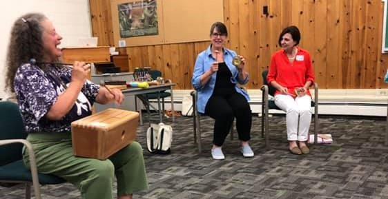 Corinne Rockow leading a music session at Higgins Lake Retreat