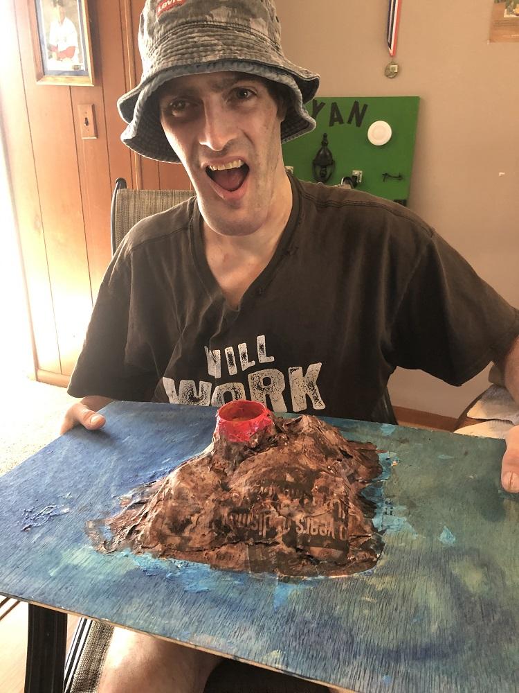 Club Create member showing his volcano artswork at home