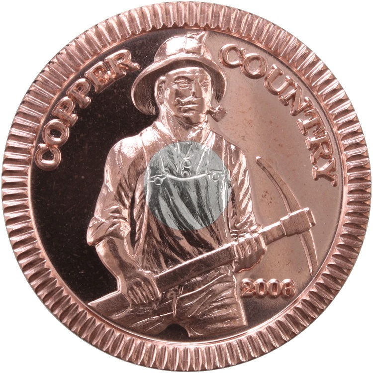 Copper Country coin with a miner on it