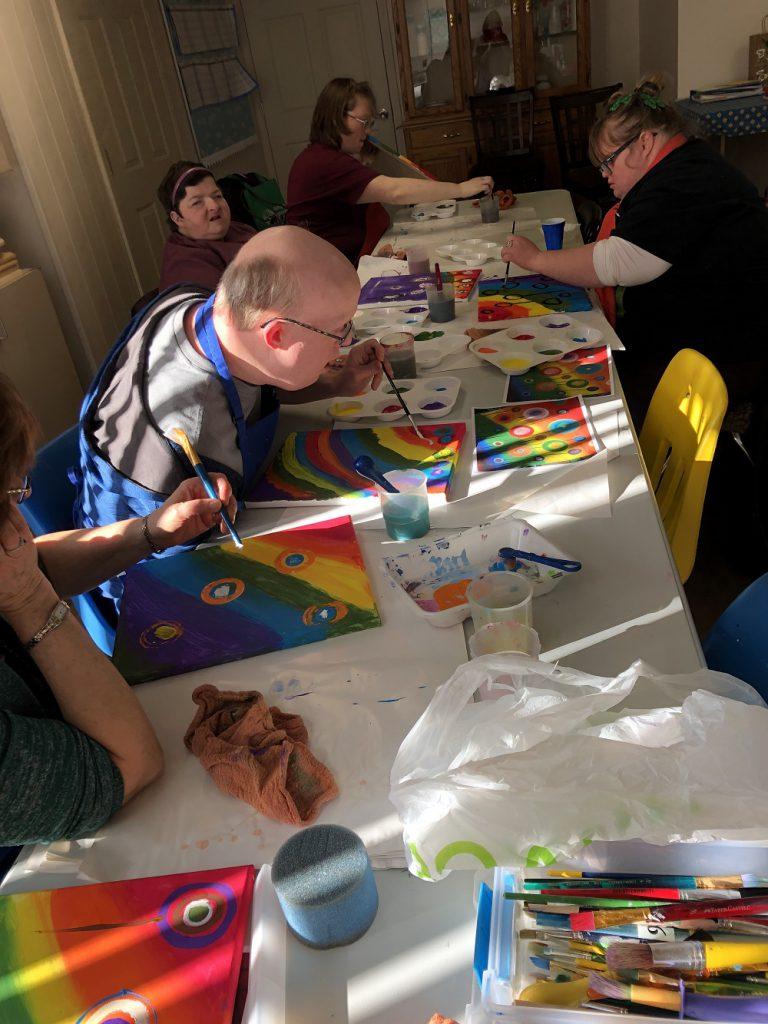 Club Create Swartz Creek members working on their rainbow paintings