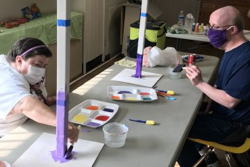 2 Club Create members working on an art project while social distancing and wearing masks
