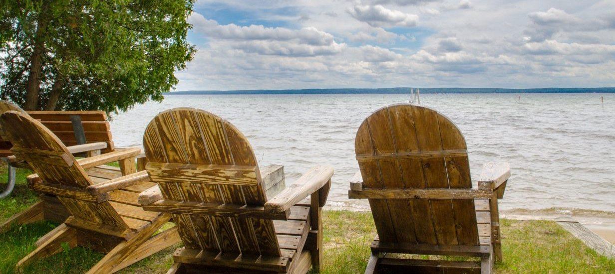 2 adirondack chairs overlooking higgins lake